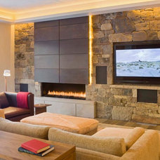 Rustic Family Room by Zone 4 Architects, LLC