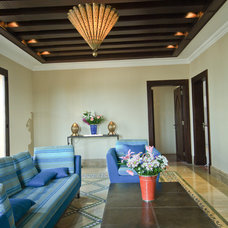 Mediterranean Family Room by Draw Link Group