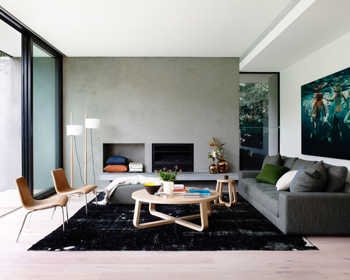 this is an example of a mid sized modern open concept family room in melbourne