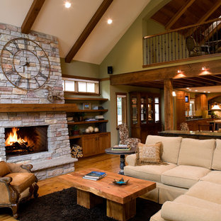 Elegant family room photo in Minneapolis with green walls and a stone fireplace