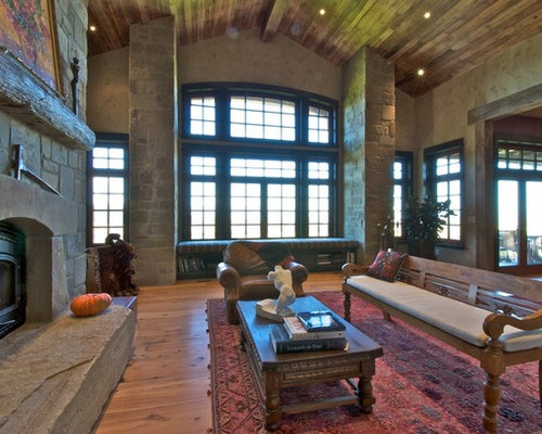 Example Of A Mountain Style Family Room Design In Denver With Stone Fireplace