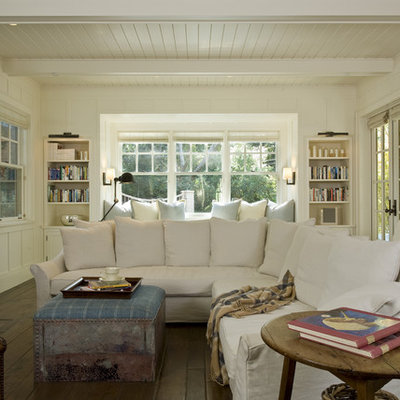 Inspiration for a timeless family room remodel in San Francisco with beige walls, a standard fireplace, a wall-mounted tv and a plaster fireplace