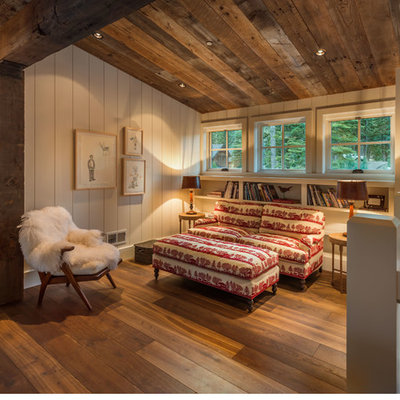 Mid-sized mountain style loft-style medium tone wood floor family room library photo in Sacramento with white walls, no fireplace and no tv