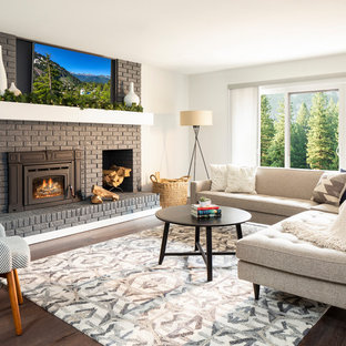 Transitional dark wood floor family room photo in Denver with white walls, a wood stove, a brick fireplace and a wall-mounted tv