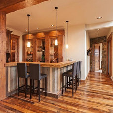 Rustic Family Room by LANDMARK TRADITIONS