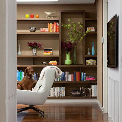 Family room library - contemporary dark wood floor family room library idea in New York with beige walls