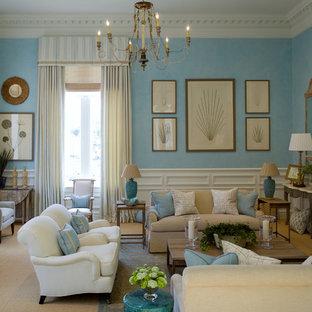 Esempio di un grande soggiorno classico aperto con pareti blu, moquette, camino classico e cornice del camino in pietra