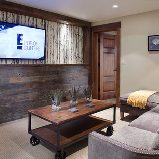 Inspiration for a rustic enclosed family room remodel in Denver with a wall-mounted tv
