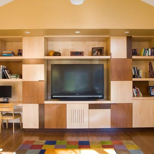 Inspiration for an eclectic medium tone wood floor family room remodel in Chicago with beige walls and a media wall