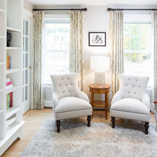 Inspiration for a mid-sized timeless enclosed light wood floor family room remodel in Portland Maine with a music area, gray walls, no fireplace and no tv