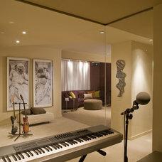 Contemporary Family Room by Ernesto Santalla PLLC