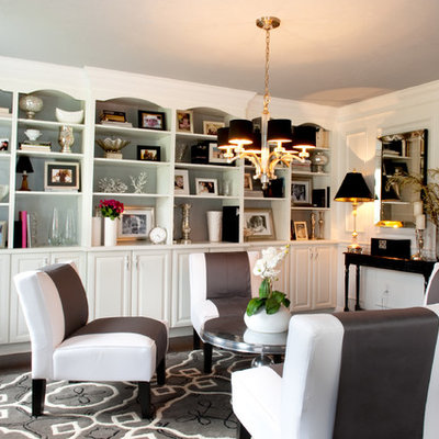 Example of a classic enclosed dark wood floor family room design in Boston with white walls and no tv