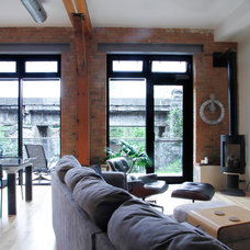 Industrial Family Room by Esther Hershcovich