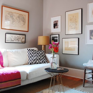 Eclectic family room photo in New York with gray walls