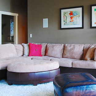 Example of a coastal enclosed family room design in New York with gray walls