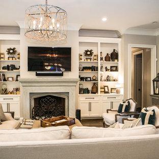 Idée de décoration pour une grand salle de séjour tradition ouverte avec un mur beige, un sol en bois brun, une cheminée standard, un manteau de cheminée en carrelage, un téléviseur fixé au mur et un sol marron.