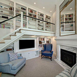 Example of a small beach style carpeted and gray floor family room library design in Minneapolis with a standard fireplace, a stone fireplace, a media wall and white walls