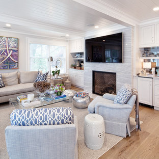 Transitional open concept light wood floor family room photo in New York with a bar, white walls, a standard fireplace, a stone fireplace and a tv stand