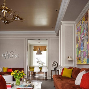 Inspiration for a contemporary enclosed family room remodel in New York with gray walls and no tv