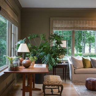 Example of a large enclosed light wood floor family room design in New York with green walls