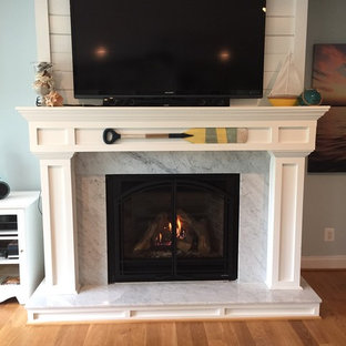 New gas fireplace with cottage design and marble surround