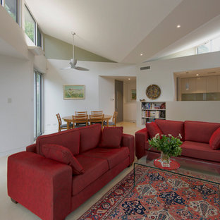 Example of a mid-sized open concept concrete floor family room design in Adelaide with white walls, a corner fireplace, a plaster fireplace and no tv