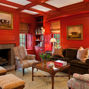 Elegant family room photo in Philadelphia with red walls and a brick fireplace