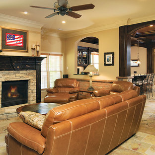 Example of a large mountain style open concept slate floor game room design in Atlanta with beige walls, a standard fireplace, a stone fireplace and no tv