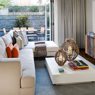 Photo of a contemporary family and games room in San Francisco with beige walls and carpet.