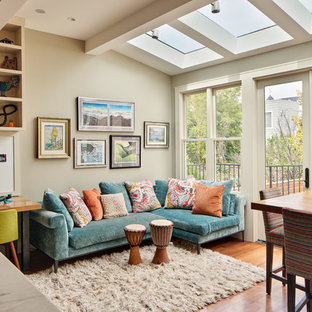 Transitional open concept medium tone wood floor family room photo in San Francisco with gray walls and no fireplace