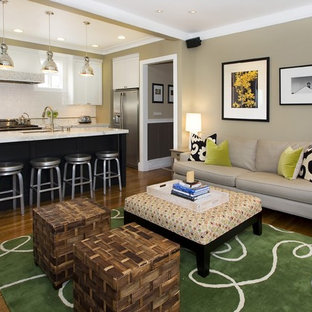 Trendy open concept medium tone wood floor family room photo in San Francisco with beige walls