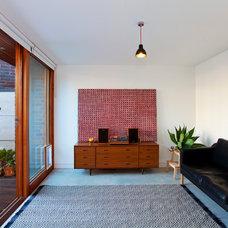 Contemporary Family Room by Angus Mackenzie Architect