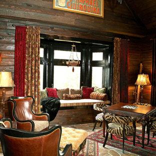 Idée de décoration pour une salle de séjour bohème de taille moyenne et fermée avec un mur gris, un sol en ardoise et aucune cheminée.