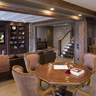 Example of a large classic open concept carpeted game room design in Minneapolis with brown walls, a media wall and a standard fireplace