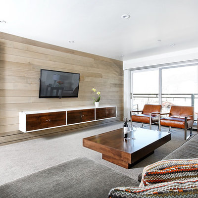 Example of a large trendy open concept carpeted and gray floor family room design in Denver with white walls, a wall-mounted tv and no fireplace