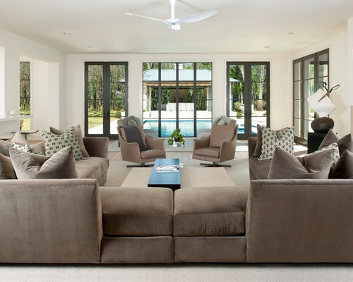 Trendy Open Concept Family Room Photo In Dallas With Beige Walls And A Wall Mounted