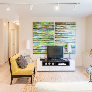 Example of a transitional open concept light wood floor family room design in New York with white walls, no fireplace and a tv stand