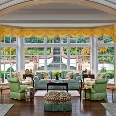 Inspiration for a timeless dark wood floor family room remodel in Philadelphia with beige walls