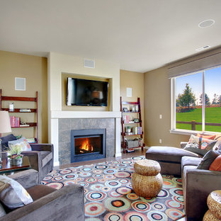 Example of a trendy family room design in Seattle with beige walls and a tile fireplace