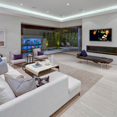 Example of a large trendy open concept porcelain tile family room design in Los Angeles with a ribbon fireplace, white walls, a plaster fireplace and a wall-mounted tv
