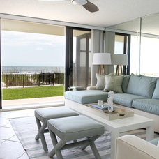 Tropical Family Room by Troy Spurlin Interiors
