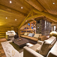 Rustic Family Room by Sticks and Stones Design Group inc.