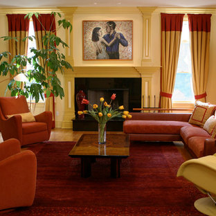 Large transitional family room photo in New York with yellow walls, a standard fireplace, a stone fireplace and a media wall