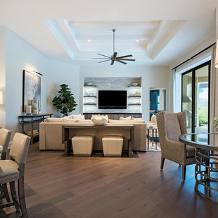 Mid-sized trendy open concept dark wood floor and gray floor family room photo in Other with gray walls and a media wall