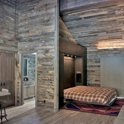 Inspiration for a mid-sized rustic open concept brown floor family room remodel in Denver with gray walls, a standard fireplace, a stone fireplace and a wall-mounted tv