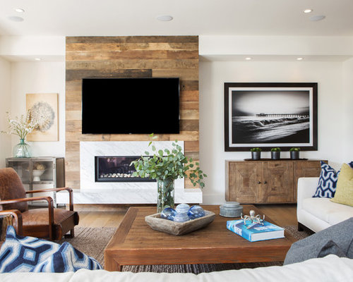 Coastal Family Room Photo In Orange County With White Walls, A Ribbon  Fireplace, A