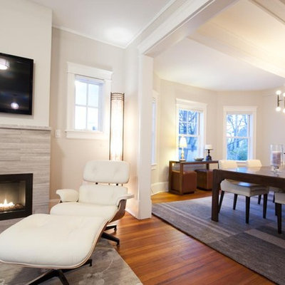 Inspiration for a mid-sized transitional open concept medium tone wood floor and brown floor family room remodel in New York with beige walls, a ribbon fireplace, a wall-mounted tv and a stone fireplace