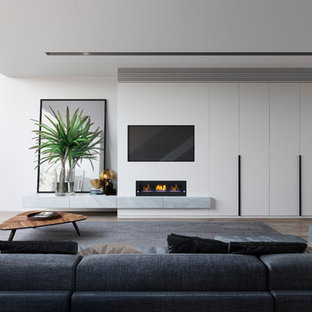 Inspiration for a modern open concept family room in Melbourne with white walls, a ribbon fireplace and a built-in media wall.