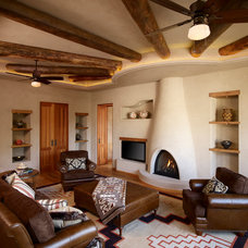 Rustic Family Room by Harvest House Craftsmen