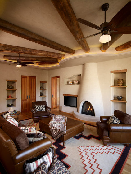 Southwestern Family Room by Harvest House Craftsmen